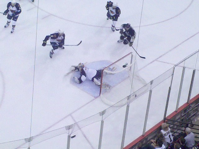 Johan Hedberg is beaten by Malkin in the second period.