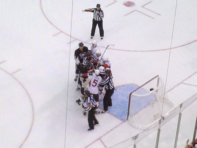 Pens and Senators having a meet and greet in front of the net.
